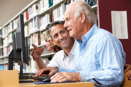 qualifications: Students working on computers in library