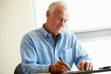 older men: Mature student in class Stock Photo