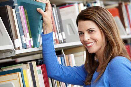 coursework: Mature student in library Stock Photo