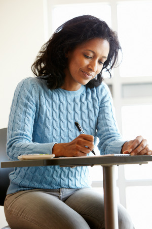 late 40s: Mature student in class Stock Photo