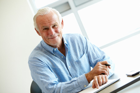 Mature student in class Stock Photo