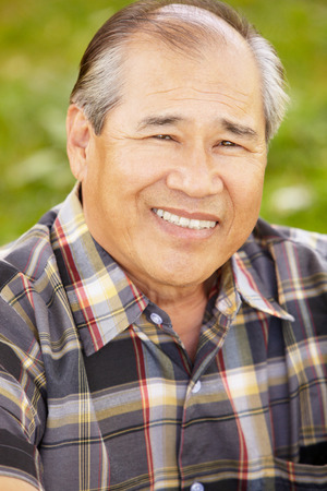 Portrait senior Asian man outdoors Stock Photo