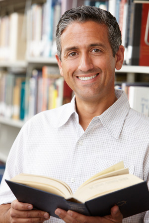 40s adult: Mature student in library Stock Photo