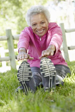 senior african: Senior African American Woman Exercising In Park