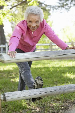 old women: Senior African American Woman Exercising In Park