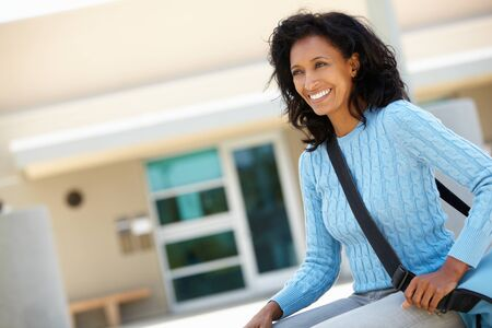 coursework: Mature student outdoors Stock Photo