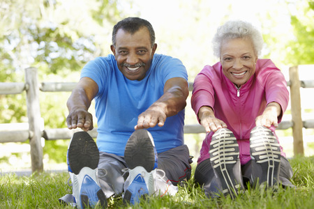 Senior African American Couple Exercising In Park Stock Photo - 42109738