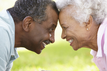 senior african: Portrait Of Romantic Senior African American Couple In Park