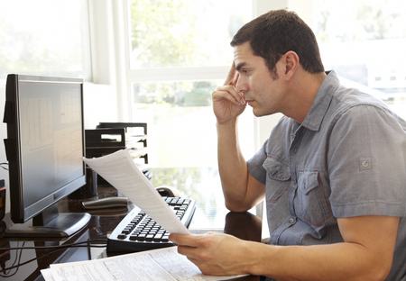 working at home: Hispanic man working in home office