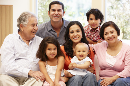 grandfather and grandmother: 3 generation Hispanic family at home