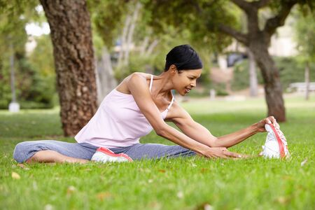 warm up exercise: Woman exercising in park
