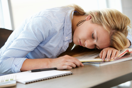 slumped: Teenage girl asleep in class