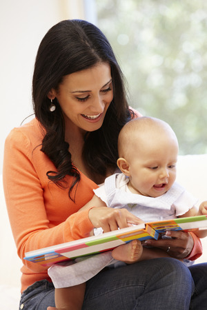 lap: Hispanic mother and baby at home Stock Photo