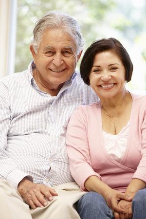 Senior Hispanic couple at home Stock Photo