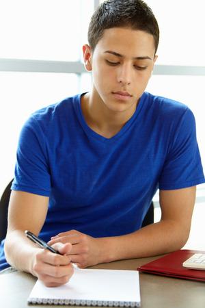 school work: Teenage boy in class