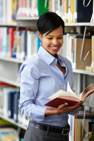 researcher: Woman working in library Stock Photo