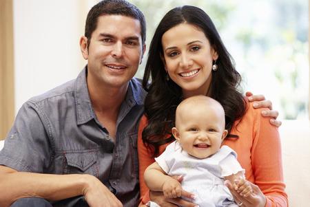 hispanic mother: Hispanic couple at home with baby