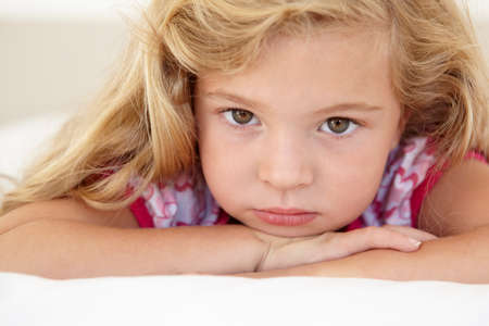 blonde females: Young Girl Looking Sad On Bed In Bedroom