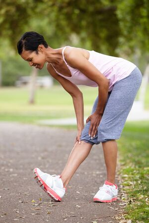 fits in: Woman exercising in park
