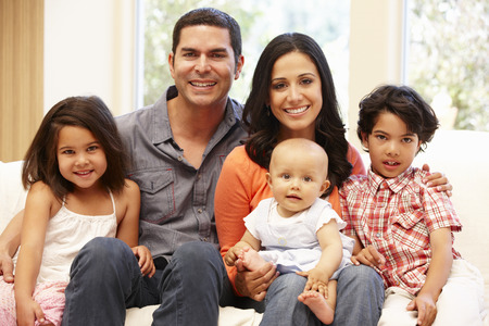 family sofa: Hispanic family at home