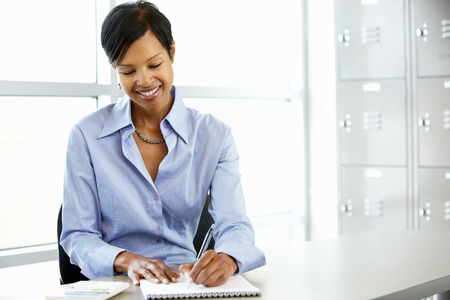 working desk: African American woman working at desk Stock Photo