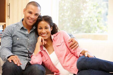 mixed race couple: Mixed race couple at home Foto de archivo