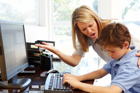 inappropriate: Mother and son using computer at home