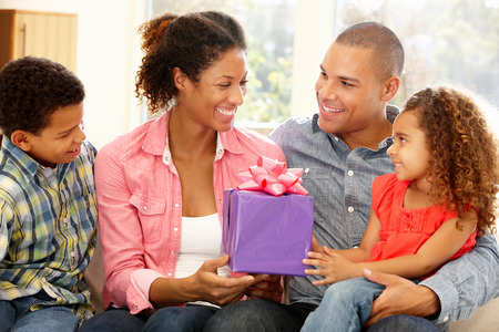 giftwrapped: Family giving gift to mother