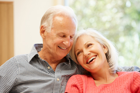 elderly adults: Senior man and daughter at home Stock Photo