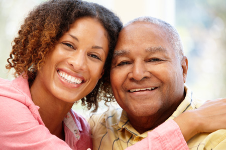 people sitting: Senior African American man and granddaughter Stock Photo