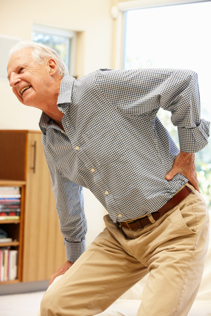 lower back pain: Senior man with backache Stock Photo