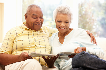 relaxing at home: Senior African American couple reading