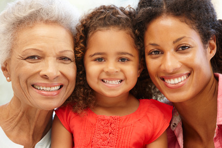 grandmother grandchild: Mother,daughter and granddaughter Stock Photo