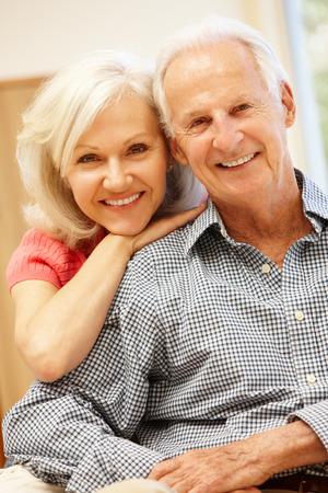 younger: Senior man and daughter at home Stock Photo