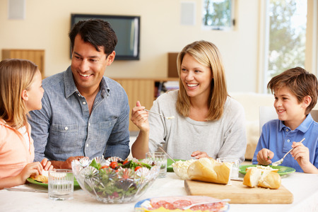 family indoors: Family sharing meal