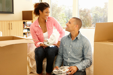 new home: Mixed race couple in new home Stock Photo