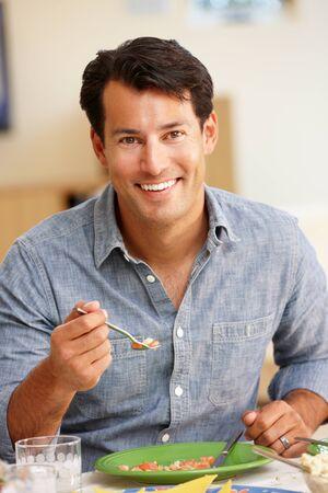 man looking: Man eating meal Stock Photo