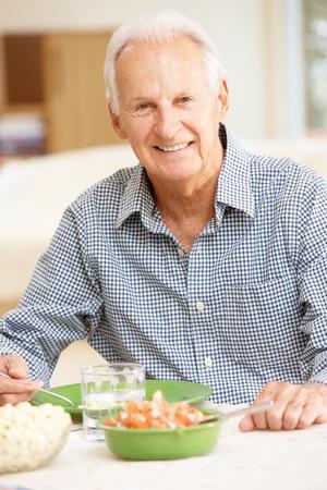 eating dinner: Senior man eating meal