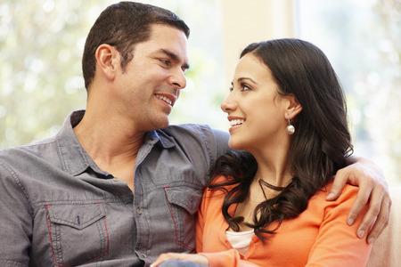 happily: Hispanic couple at home Stock Photo