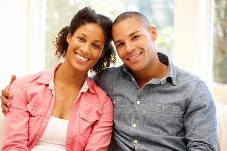 mixed race: Mixed race couple at home Stock Photo