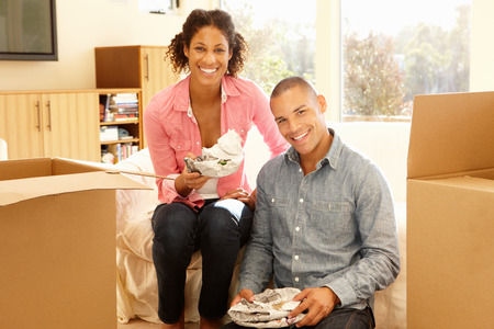 Mixed race couple in new home Stock Photo