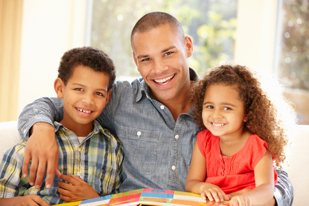 5 10 year old girl: Father reading to children Stock Photo
