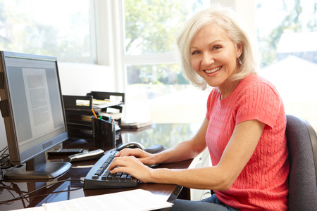 Woman working in home office Foto de archivo