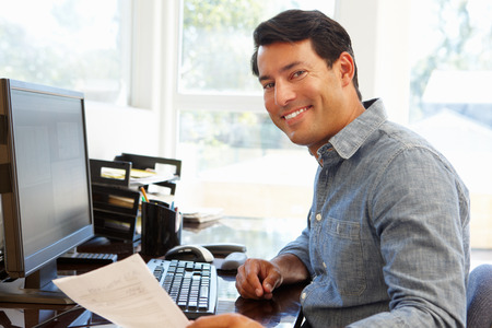 working at home: Man working in home office