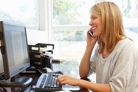 working woman: Woman working in home office Stock Photo