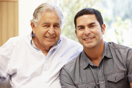 elderly adults: Hispanic father and adult son Stock Photo