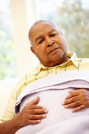 senior african: Unwell senior African American man Stock Photo