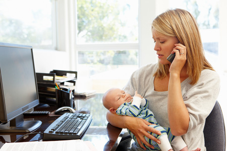 stressed business woman: Mother working in home office with baby Stock Photo
