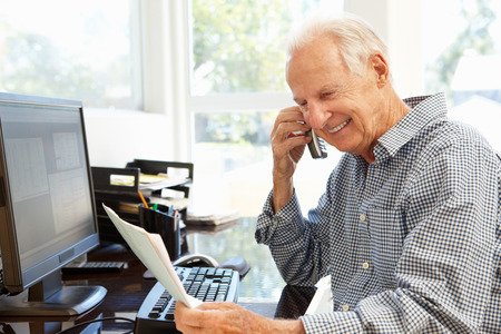 working: Senior man working at home