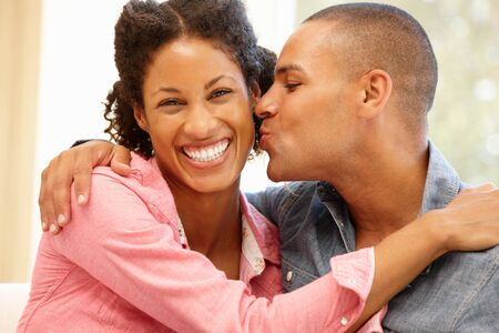 mixed race couple: Mixed race couple at home Stock Photo